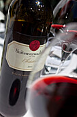 Bottle and wine glasses at Restaurant Buitenverwachting, Constantia, Cape Town, South Africa, RSA, Africa