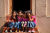 Group of four girls at Bo Kaap Malay Quarter, Cape Town, West Cap, South Africa, Africa