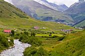 Urseren valley with river Furkareuss, Glacier Express train in the background  Andermatt, Uri, Switzerland
