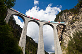 Train, Glacier Express, crossing the Landwasser Viaduct near Filisur, Graubuenden, Switzerland