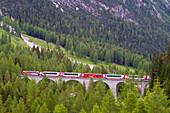 Train, Glacier Express, crossing a viaduct on the Albula line, Albula Valley, Graubuenden, Switzerland