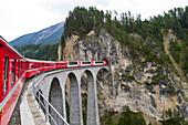 Train, Glacier Express, crossing the Landwasser Viaduct near Filisur, Graubuenden, Switzerland