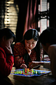 Chinese women playing the board game Chinese checkers in Pingyao, a UNESCO World Heritage Site, Shanxi Province, China