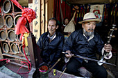Musicians busking for a living, Lijiang, Yunnan Province, China
