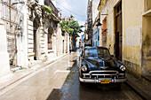 Vintage car parked in street, Havana, Cuba