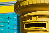 Yellow post box and turquoise PO boxes, Cyprus