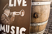 Sign for live music next to barrel, Nyhavn, Copenhagen, Denmark