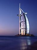 The Burj al-Arab or Arabian Tower at dusk, Dubai, United Arab Emirates