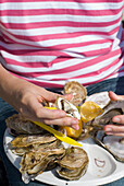 Woman eating oysters in Cancale, Close Up, Brittany, France