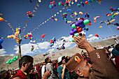 Monks with thousands of multi colored balloons at 800 year old birthday celebration / rituals of the Buddhist Drukpa Lineage, Naro Photang Shey, ( Shey Monastery ), Leh Ladakh, Indian Himalayas, India, Monks with thousands of multi coloured balloons at 80