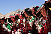 Row ao women in traditional dress praying at Shey Monastery, Nubra Valley, Leh Ladakh, India, 800 year old birthday celebration, rituals of Buddhist Drukpa Lineage