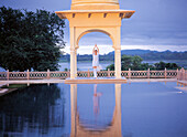 Yoga in the archway of Udaivila, Udaipur, Rajasthan, India
