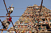 Men working on scaffolding in front of Kapaleeshwarar Temple, Mylapore, Chennai, India