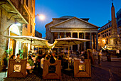 People in outdoor cafe in front of Pantheon at dusk, Rome, Italy