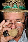 Truffle hunter smells truffle, Alba Truffle Festival, Piedmont, Italy
