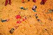 Submerged in oranges at Orange Festival, Ivrea, Italy