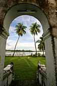 View through archway towards Mekong river and palm trees, Don Khong Island, Champasak Province, Si Phan Don Islands