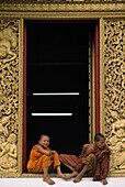 Monks in the window , Luang Prabang, Laos.