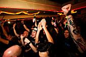 Crowd cheering during rock gig at The CroBar, London, England