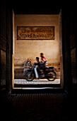 Motorbike passing entrance of Ali Ben Youssef Medersa, Marrakesh, Morocco