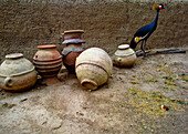 Pots and bird in Segou, Mali, West Africa