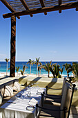 Dining tables by beach, Los Cabos, Mexico