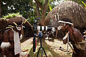 Warrior of Dani Tribe marvel at Camera, Baliem Valley, West Papua, Indonesia