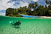 Scuba Diver in Lagoon of Ahe Island, Cenderawasih Bay, WestPapua, Papua New Guinea, New Guinea, Oceania