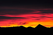 Clouds above silhouettes of Untersberg and Sonntagshorn in the afterglow, view from Lacherspitze, Wendelstein range, Bavarian alps, Upper Bavaria, Bavaria, Germany, Europe