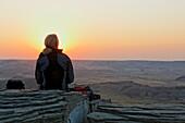 One woman enjoying the sunset, Theodore Roosevelt National Park, Medora, North Dakota, USA