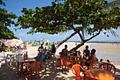 People relax at beach bar overlooking Olinda beach, Olinda, near Recife, Pernambuco, Brazil, South America