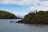 People on coastal platform with cruise ship MS Deutschland, Reederei Peter Deilmann, in distance, Cabo Frio, Rio de Janeiro, Brazil, South America