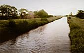 Farm house at a canal, East Frisian Wadden Sea, East Friesland, North Sea, Lower Saxony, Germany, Europe
