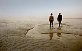 Two men in the Wadden Sea, East Frisian Wadden Sea, East Friesland, North Sea, Lower Saxony, Germany, Europe