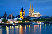 View over the Rhine river to church Groß St. Martin and cathedral in the evening, Cologne, North Rhine-Westphalia, Germany, Europe