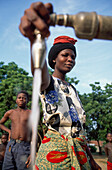 Woman pours water from faucet, Malawi
