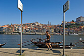 A man jogging along the quayside at Oporto, Portugal