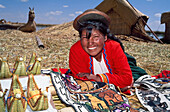 Uros Indian woman with artisan goods, Lake Titicaca, Peru