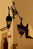 Lamp and shadow on yellow wall, Main Market Square, Krakow, Poland