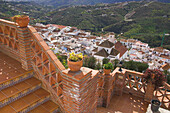 View from brick patio of small whitewashed village nestled in mountains, Frigiliana, Costa del Sol, Spain