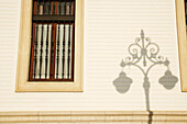 Window and street lamp shadow, Seville, Spain