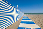 Walkway and wind break on beach, Torremolinos, Andalucia, Spain