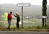 A pilgrim talks to a local, Santiago de Compostela, Galicia, Spain