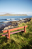 Empty sandy beach with grass in background, St Ninian's Isle, Shetland Islands, Scotland