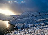 Fresh winter snow and lake, Torridon Range, West Coast, Scotland
