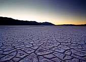 Looking across the purple saltpans at Badwater at dusk, Death Valley National Park, California
