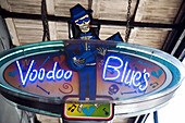 Neon sign adverting Voodoo Blues bar, French Quarter, New Orleans, Louisiana, USA
