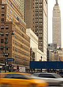 Empire State Building and passing cars, Manhattan, New York City, New York