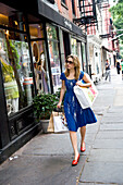 Woman shopping in West Village, New York City, USA.