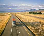 Truck on highway, blurred motion, Utah, United States